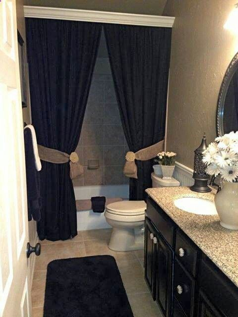 This is the exact layout of guest bath; like the shower curtain/crown molding idea and beadboard on the wall.