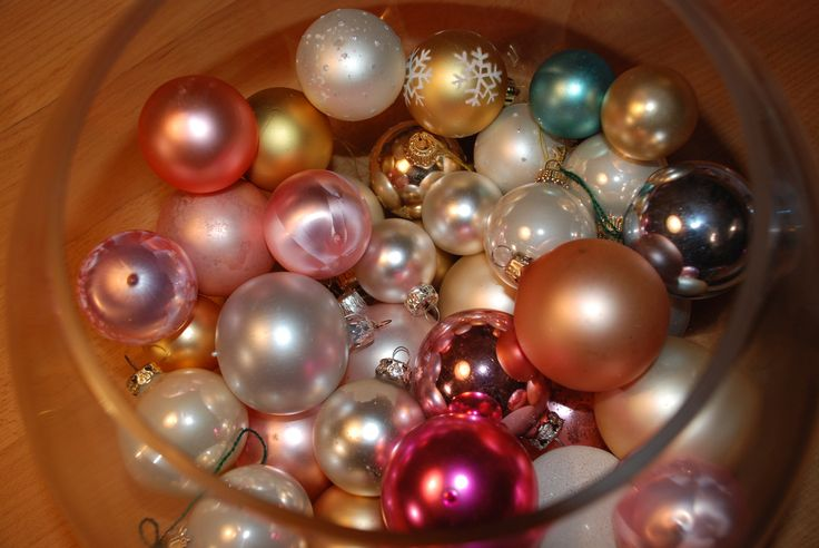 A bowl of pastel vintage baubles - all found in the thrift store nearby