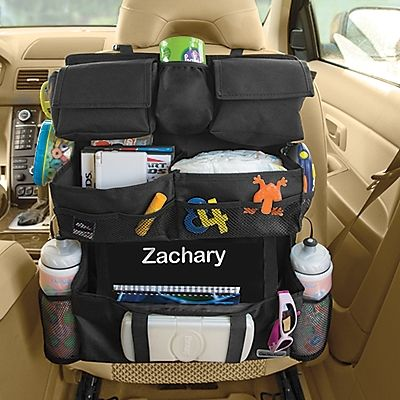 Backseat Car Organizer Holds Kids Entertainment & Travel Toys - lots of other great travel items, too.