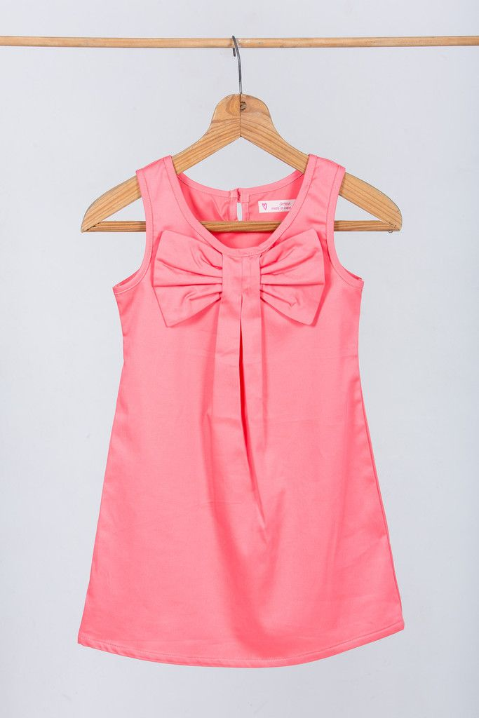 "Flower girl dress : ""Olivia"" made by GHAM Price: R599. A beautiful coral cotton slip dress. Accentuated with a cheeky bow and pleats. Cape Town, South Africa."