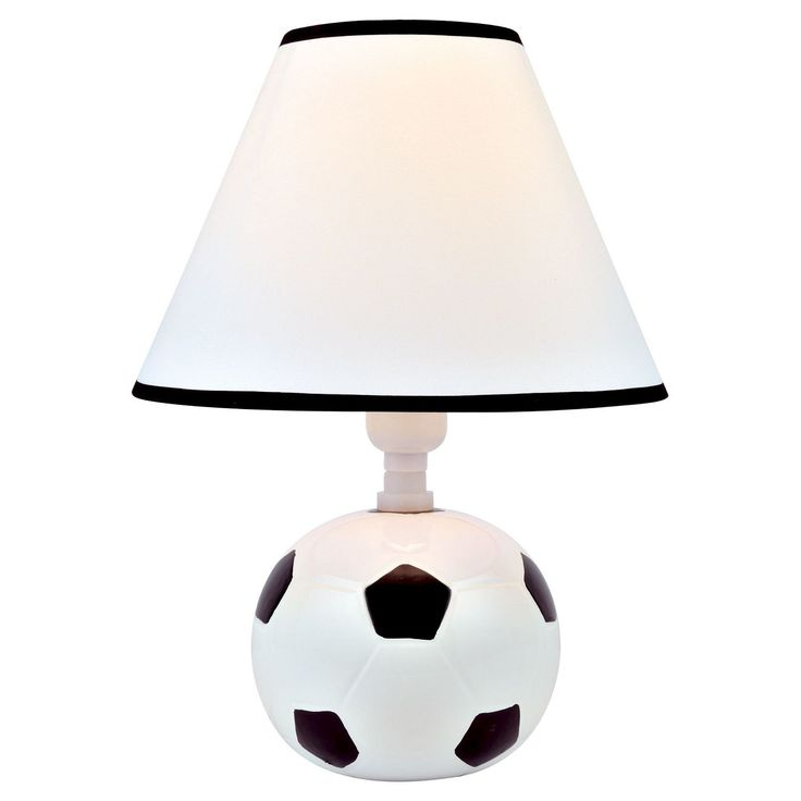 Perfect for the soccer fan in the house, the Lite Source Kick Me Table Lamp Soccer scores big with style. The white and black ceramic base brings a soccer ball to life, while the white shade with contrasting black accents gives the playful lighting a style boost. The kids will go crazy for this light on their sport. Goal!
