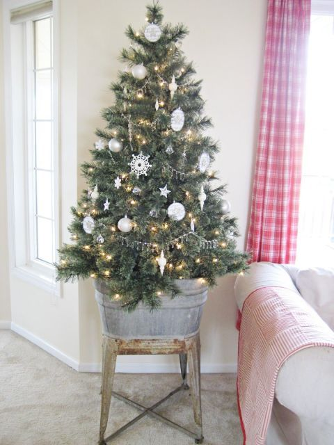 Don't feel pressured to shove a too-big tree into your small living room. Instead, choose a smaller tree, and raise it up on a platform. That way, you get the perceived size and commanding presence of a larger tree without taking up so much floor space. For inspiration, look at Happy At Home's small tree: Raised off the ground, it's much less intrusive without sacrificing the holiday spirit.