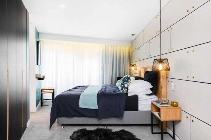 Cool, contemporary and edgy bedroom featuring concrete panel wall with brass studs and green wall colour. See loads more pics from this bedroom and other bedrooms from The Block 2015.