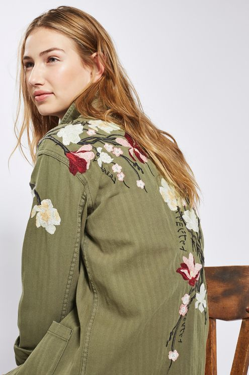 We love the contrasting elements of this cool shacket in khaki. Crafted in rich cotton, it features 4 practical pockets and button-up fastening, and comes with pretty floral embroidered detail to one arm and the back. Wear as a light jacket over a casual tee, or as a shirt to pair with jeans. #Topshop