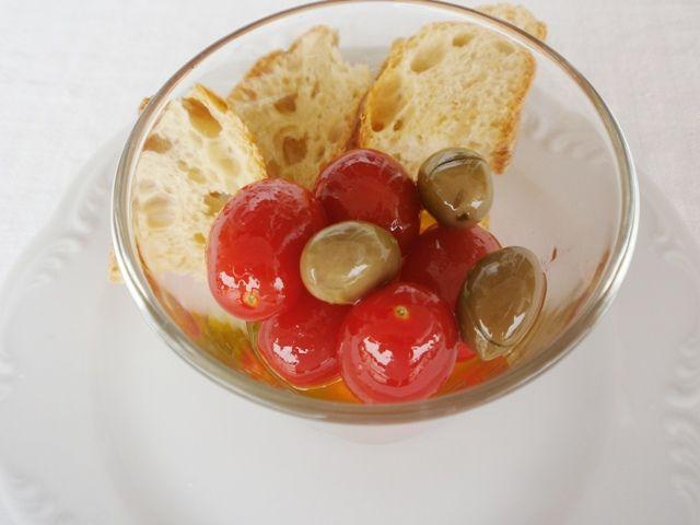 Cherry tomatoes with Honey-Raki snaps and extra virgin olive oil - Tomatinia me rakomelo kai agoourelaio #cherry_tomatoes