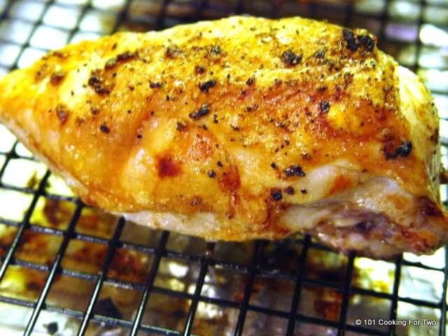 A crispy bone-in skin-on chicken breast (AKA split chicken breast) stuffed with butter and garlic. Great taste and the moistest roasted chicken ever.
