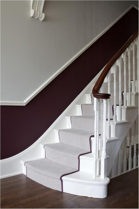 An inspirational image from Farrow and Ball A hall and stairs in Brinjal and Cornforth White Estate Emulsion with woodwork in Wimborne White Estate Eggshell.
