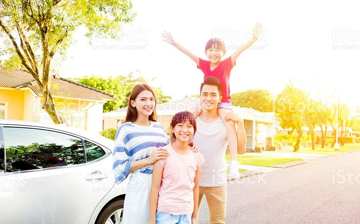 Beautiful happy family portrait  outside their  house royalty-free stock photo