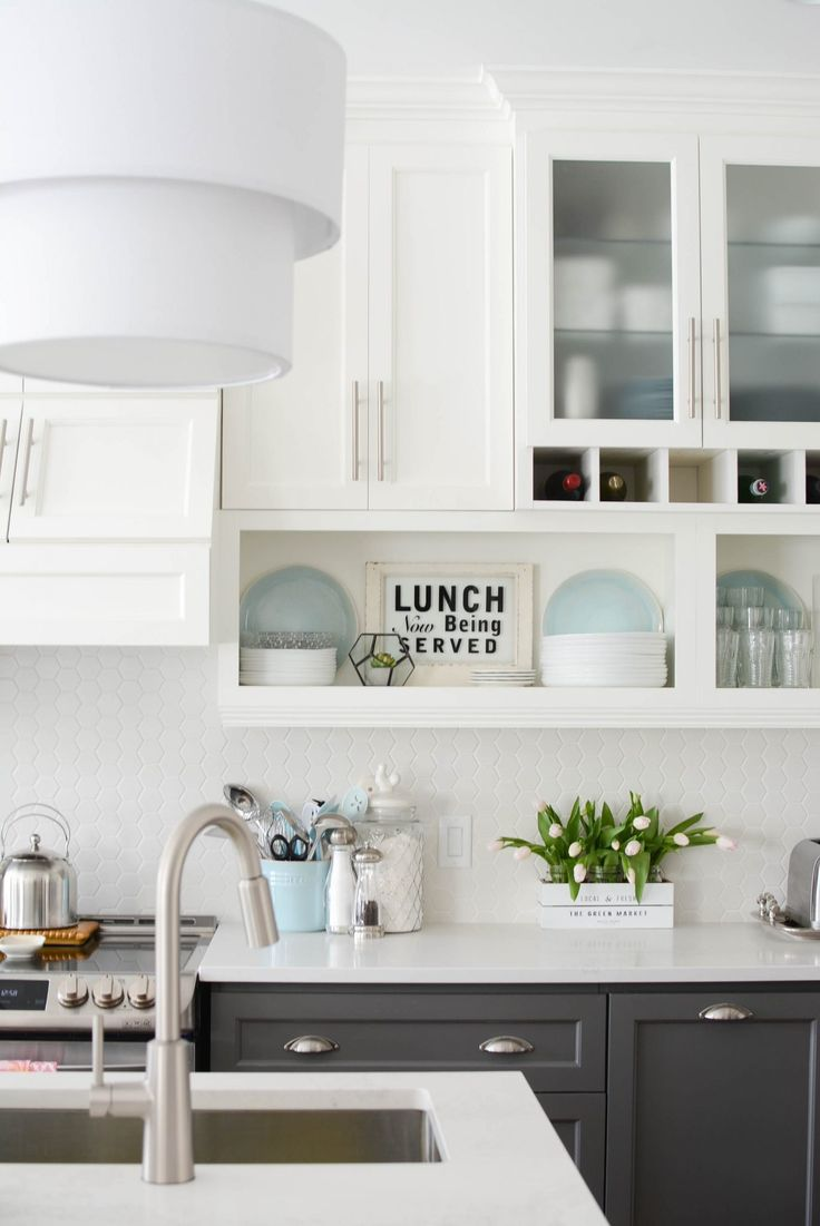 Love this kitchen renovation!   White open uppers and dark grey lower cabinets with white hex tile.