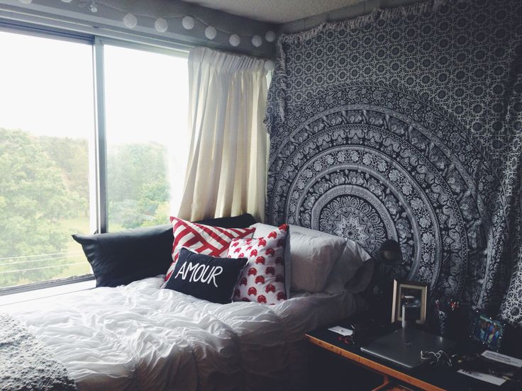 Tapestries, curtains, gallery walls, oh my! Hang absolutely anything in your dorm room with these easy hacks.