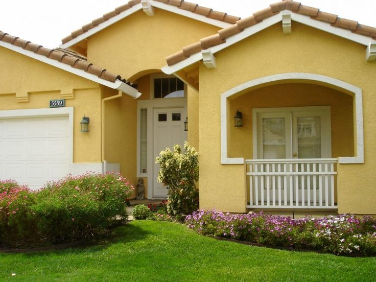 Cool Yellow Exterior Paint Feats With Nice White Garage Door And Enthralling Garden Ideas