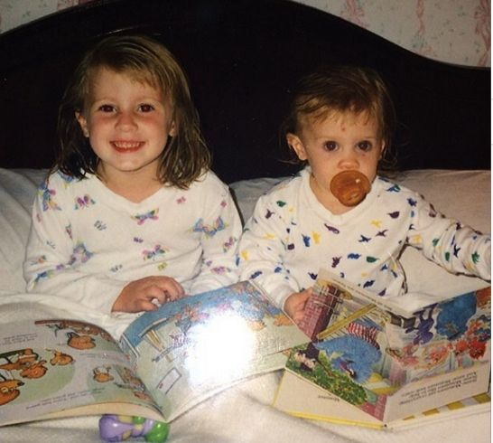 Two sisters reminiscing on Throw Back Thursday - photo of them with their Berenstain Bears books from about 1990.