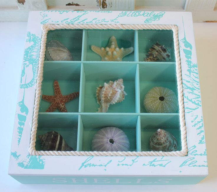 """What a fun and clever way to display shells that you've either collected at the beach yourself on a special vacation or honeymoon, or that you've chosen for our vast selection. Either way, this shell display box makes an excellent conversation piece for a coffee or console table at your beach and coastal themed home. The display box measures 10"""" x 10"""" x 2 3/4"""" and holds 9 shells, starfish or sea urchins."""
