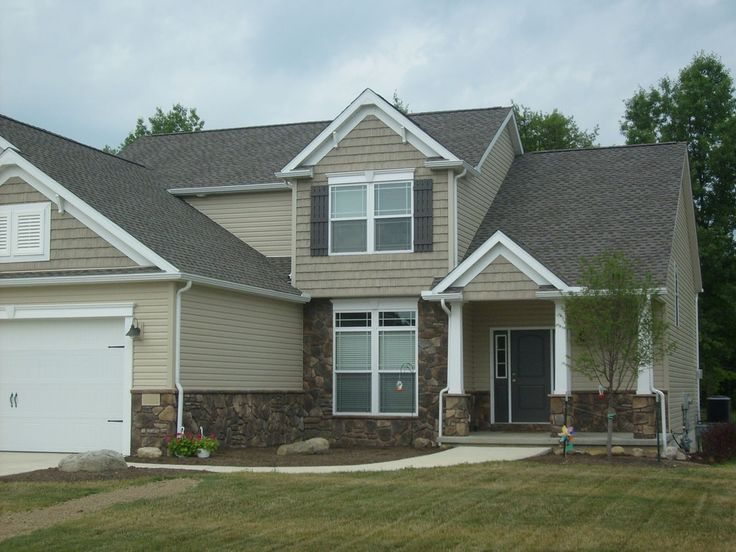 Tan siding black shutters and stone home exterior Vinyl siding that looks like stone