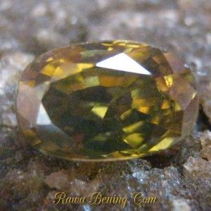 Batu Permata Asli Oval Zircon Yellowish Brown 1.79 carat
