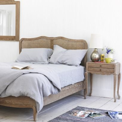 MARGOT We saw a similar French bed when staying in a particularly gorgeous house in Provence last year. We've given the solid oak a weathered finish and the rattan is super-practical.