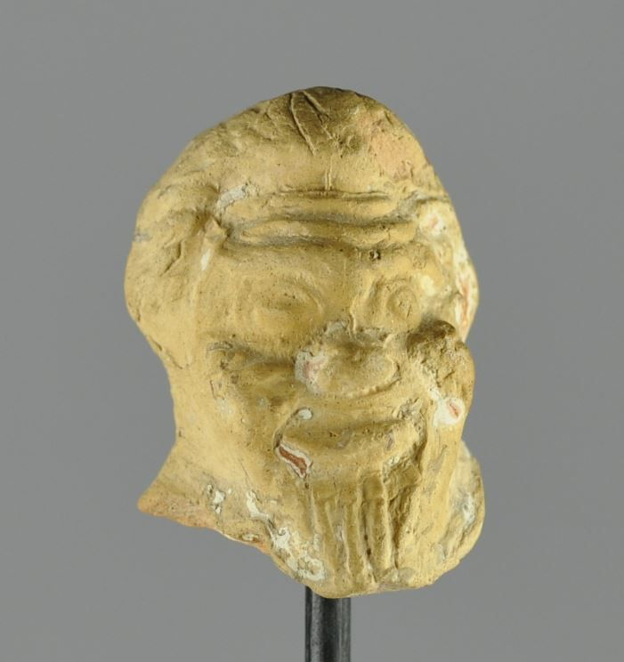 Greek terracotta head of Silenus, 4th century B.C. Greek terracotta statuette head of Silenus with long beard, 3.5 cm long. Private collection