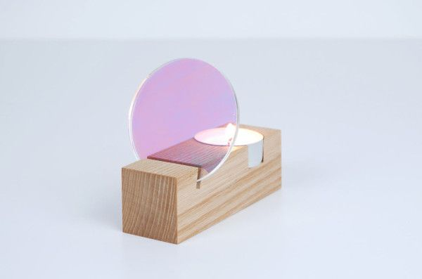 Studio Thier&vanDaalen launched a series of simple home accessories, named Interior Reflections, that focus on the play of light and reflection. Composed of chunky wooden blocks, the pieces combine disks of colored plexiglass filters and mirrors to become vases, candleholders, and mirrors.