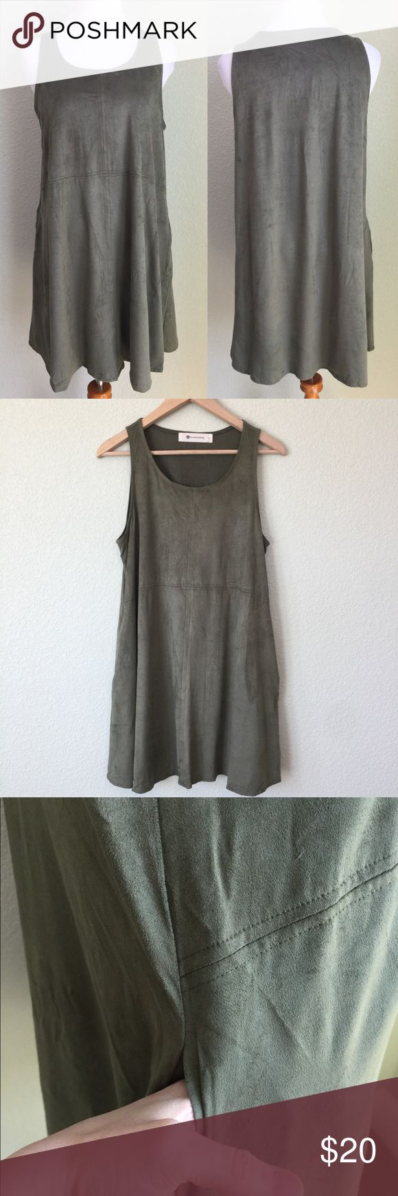 """NWOT Green Soft Suede Velvety Dress Sleeveless New, tag fell off, never worn. Sleeveless green dress. Soft suedes feel, not too thick and light enough for spring. 32"""" long, 20"""" armpit to armpit.    Has 2 pockets!    Fast shipping, no trades. Bundle discounts and offers welcome. The Impeccable Pig Dresses Midi"""