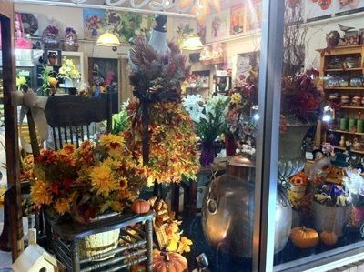 Love the old Chair! Florist Window Displays | Autumn window display at Stein Your Florist Co. | Window Displays by cindy
