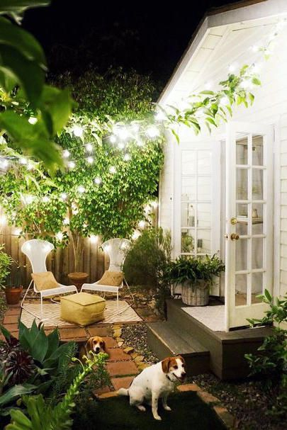Backyard Wonderland - The 19 Most Incredible Small Spaces on Pinterest - Southernliving. No need for acres of rolling hills (though we do love that too!). This tiny patio holds its own thanks to lush foliage and playful string lights.  See Pin