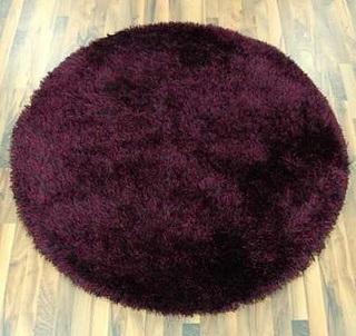 purple round by Opening the Book Ltd, via Flickr