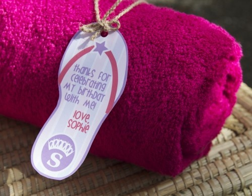 Pool Party Favor a swim towel, dressed them up with a coordinating favor tag.