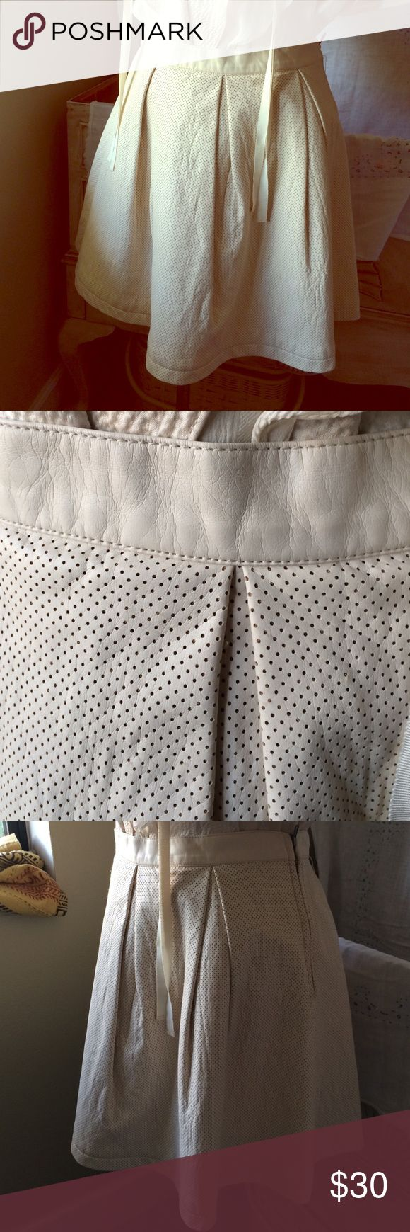 """French Connection pleather mini skirt French Connection mini skirt in vegan leather- pinhole pattern in a creamy vanilla color- large pleats with side zip. Length 17"""" long French Connection Skirts Mini"""