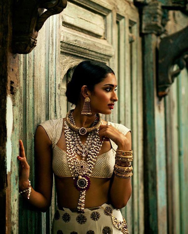 Off white lehenga with classic antique jewelry