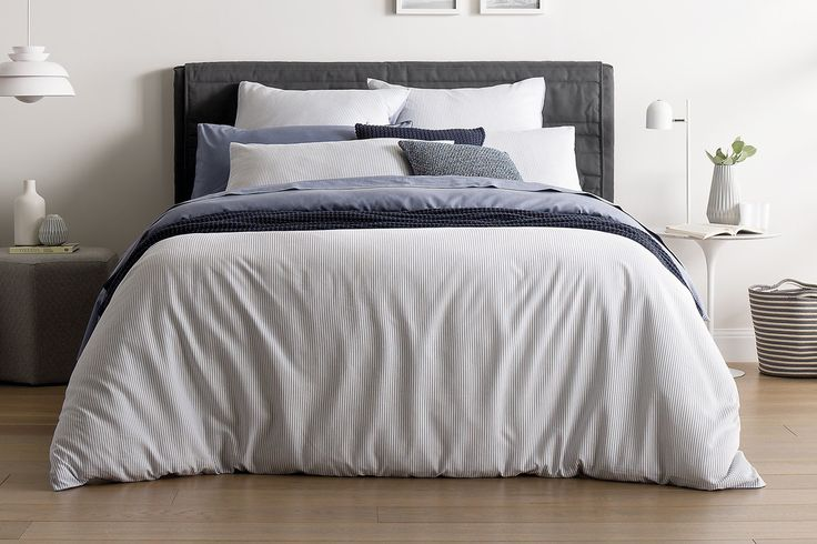 Sheridan Holmes Quilt Cover - Blue  An innovation of the Sheridan design team which combines Lyocell fibre with Cotton to create a beautiful hand-feel, perfect of a comfortable, luxurious sleep. A classic yarn dye pin stripe creates the perfect base for layering accessories.