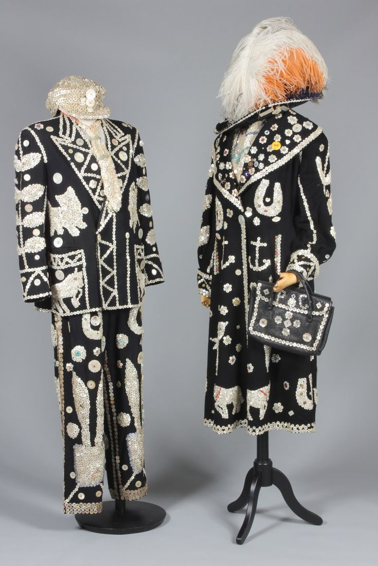 * Pearly King and Queen ensembles 1940s - King comprising ornately decorated suit, cap, tie, bow tie, brace ; the Queen with coat, chemisette, two hats, a handbag and shoes.