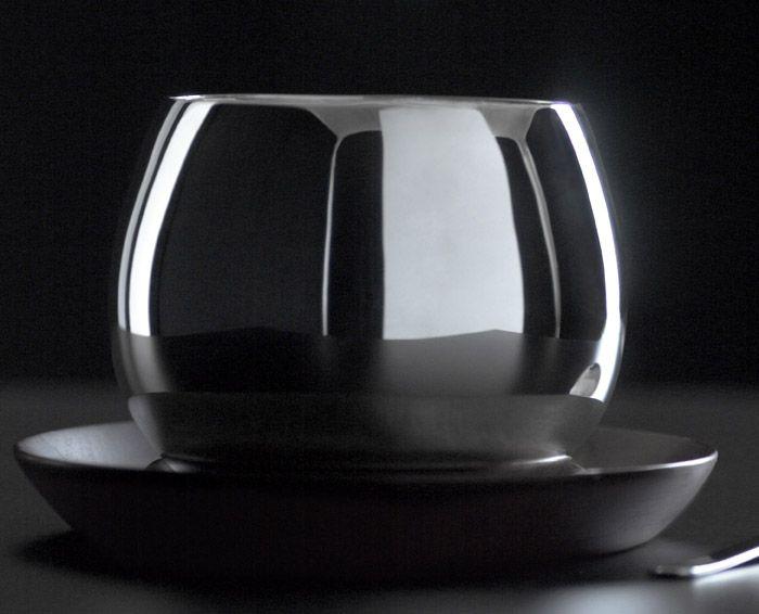 Kay Bojesen silver bowl on teak dish. Kay Bojesen silver. Danish Design