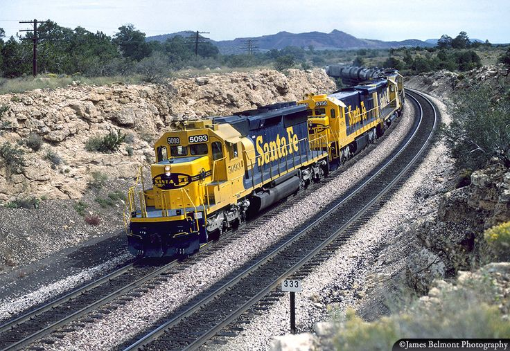 https://flic.kr/p/SPkjUA   Santa Fe Yellow & Blue at Cosnino Cut   A five pack of Santa Fe blue & yellow motors pull a heavy westbound manifest freight through Cosnino, Airzona on Sept. 30, 1990.
