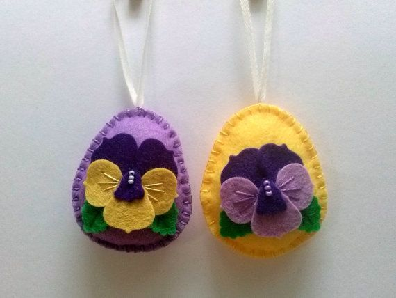 Felt easter decoration - felt egg with pansy flower  Listing is for 1 ornaments  Options: - yellow background - lilac background  Handmade from wool blend felt  Size of my decorated eggs is about 2 1/8 x 2 5/8 inch (5,3 x 6,5 cm) This is size of felt egg without hanging loop