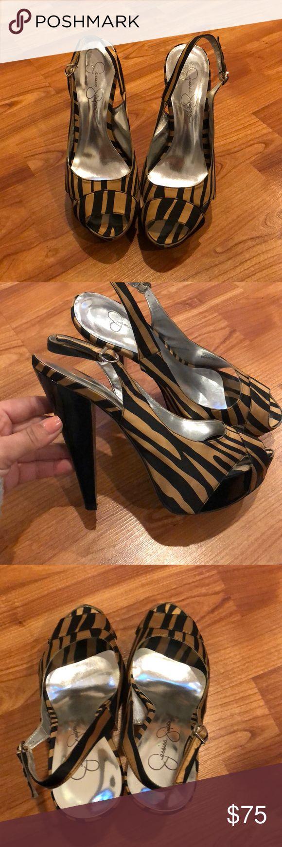 Jessica Simpson zebra heels Gold and black zebra heels with black heel. Comes with box Jessica Simpson Shoes Heels