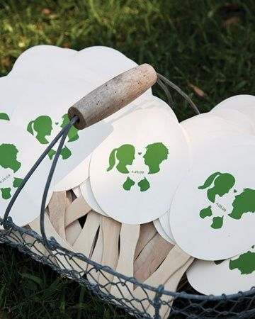 Fan Favors featuring the bride & grooms silhouettes (& their cats) from Martha Stewart Weddings