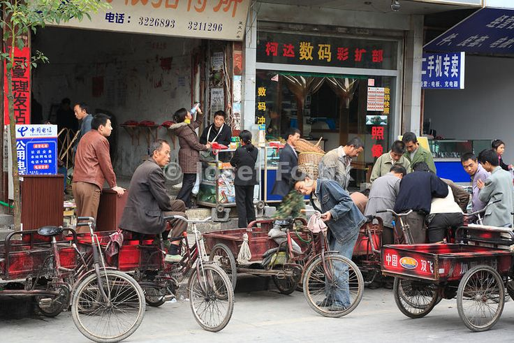 Tricycle riders, Fenghuang Town, Hunan, China