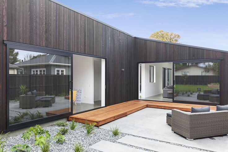 Huge sliders connect the inside with the sheltered north facing outdoor seating area