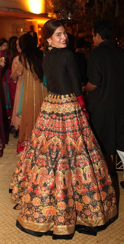 Amna Babar in Ali Xeeshan - stunning orange and black lengha -
