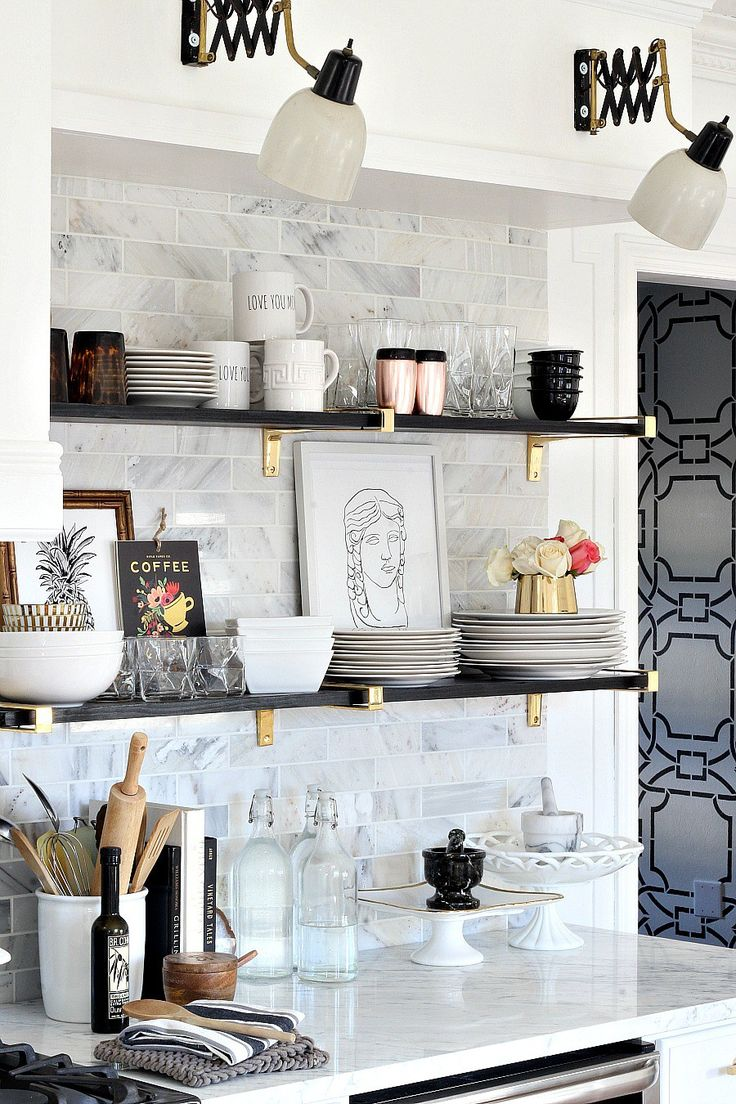 Black, gold, marble, and glam kitchen makeover reveal with open shelving, brass brackets, black and gold accordion lamps, carrara marble, and feminine touches. Very glam!