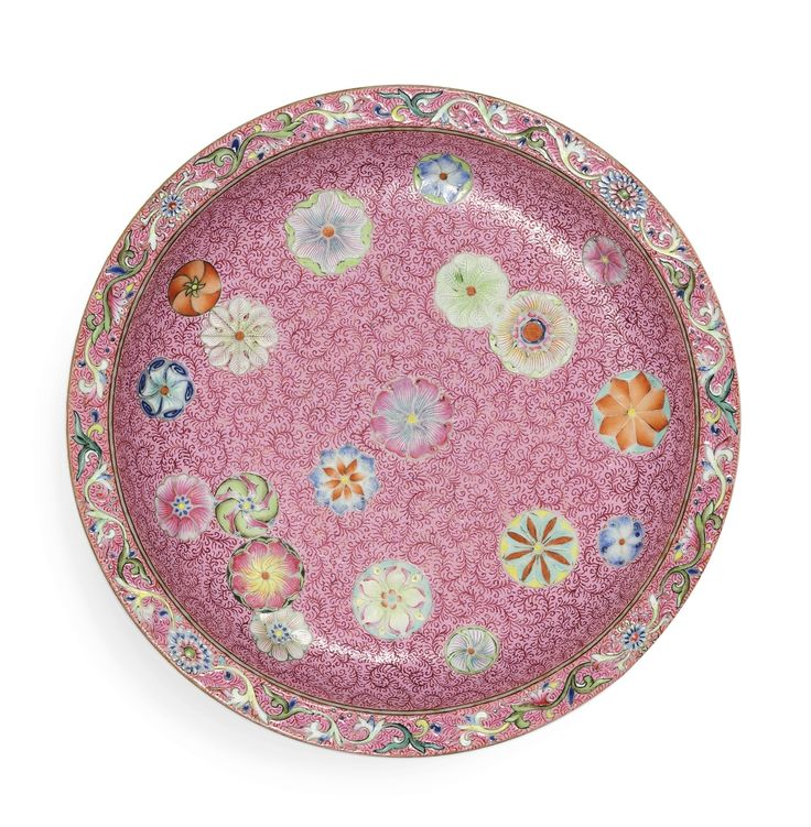 A FINE AND RARE PINK-GROUND FAMILLE-ROSE SGRAFFIATO 'FLOWER-BROCADE' SAUCER DISH, SEAL MARK AND PERIOD OF QIANLONG