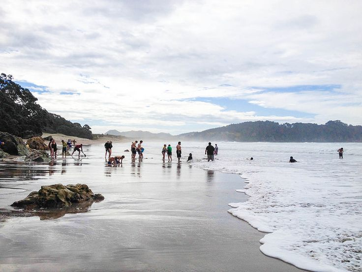 Hot Water Beach in New Zealand. Hot water bubbles up from under the rocks + sand and mixes with the surf. Love!