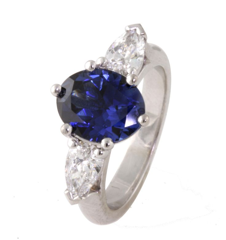 Stunning sapphire and pear shape diamond  engagement ring  in 18ct white gold