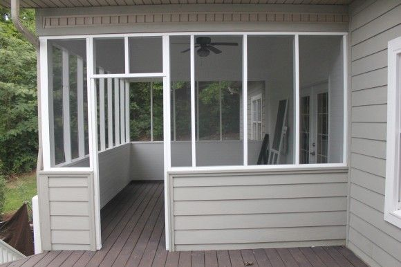 Screened in porch. I would love to do this to our back porch someday.