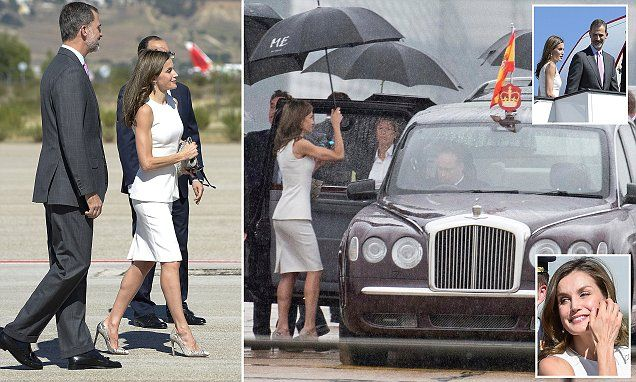 The Spanish royals were given an official farewell with honours at Adolfo Suarez Madrid-Barajas airport as they set off for London, where they were greeted with 'traditional English rain'.