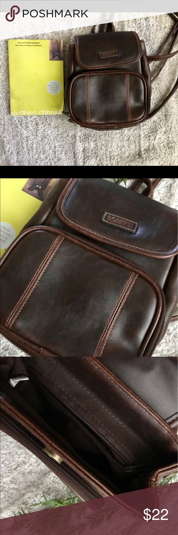 """Rosetti Mini Faux Leather Backpack Cutest little Backpack ever! Beautiful brown color.  Has two compartments in the front and one on the back. Mini Backpack measures approx. 8 1/2"""" long and 7 1/2"""" wide. Perfect little Backpack for a trip around town fits only the essentials 😉🌻♥️ Rosetti Bags Backpacks"""