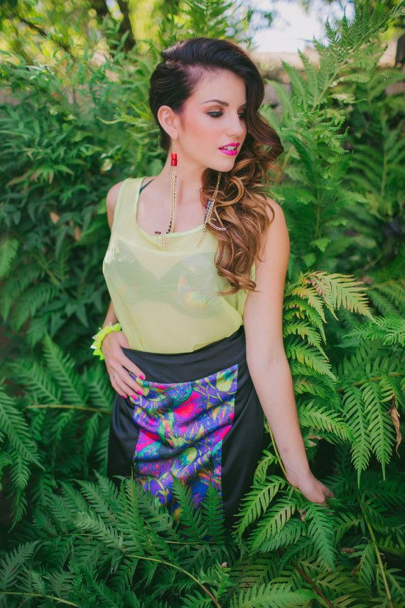 This sexy handmade satin pencil skirt features a vibrant tropical print. Pair it with a blazer for the office or with a tank for a hot date.