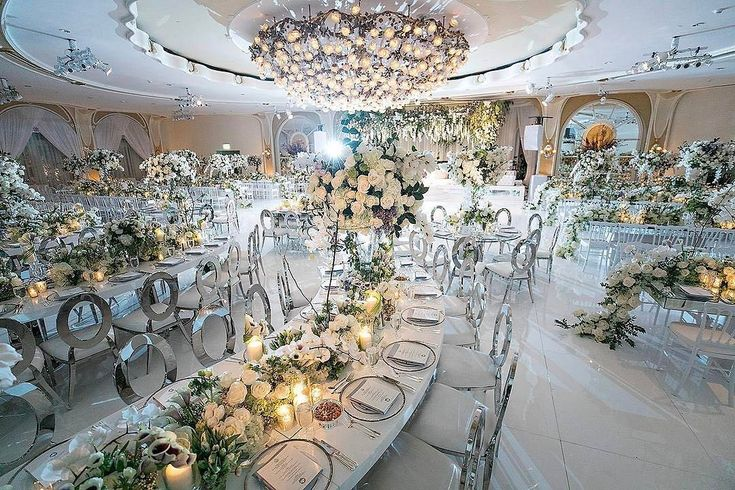 Talk about a grand reception! This space planned by @internationaleventco is heaven on earth. Venue: @BevHillsHotel, Decor: @RevelryEventDesign, Planner: @internationaleventco, Floral: @marksgarden, Photographer: @jessicaclaire, Lighting: @thelightersidela, Chandeliers: @melrosegallery, Dance Floor/Décor: @HarrysPartyRental, Linens: @wildflowerlinen, Chargers: @tacer_losangeles