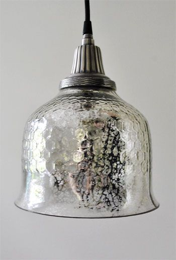 so in lust with this mercury-toned overhead light with slight honey-comb texture. great find #younghouselove