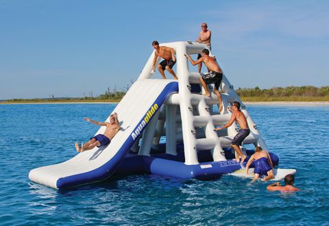 inflatable water park!!!!  Kids and adults alike can spend hours scaling the inflated rungs, and diving off of any vantage point, or sliding down the integrated slide. Heavy duty molded handles for convenient boarding and climbing. The inside areas feature meshed-bottomed splash zones, which are much like shallow pools.